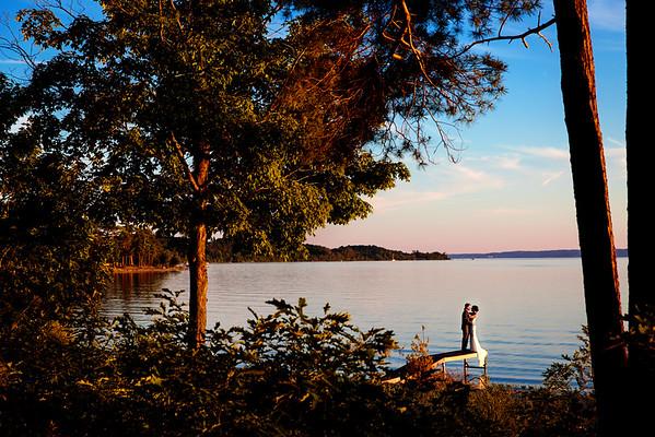Sunset on lake for bride and groom on dock   Rayan Anastor Photography   Northern Michigan Destination Wedding Photographer