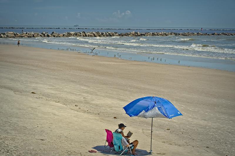 Small Spot of Shade on a Sunny Beach