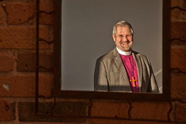 Episcopal Bishop Ian Douglas looks into a mirror inside the new home of the Episcopal Church in Connecticut on Pratt Street on November 20, 2014