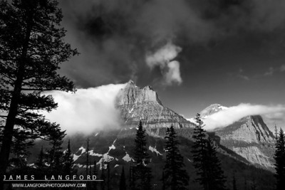 """Rolling Fog""  Glacier National Park, MT  I really love visiting Glacier.  It's different everytime I go.  On this trip, the East side of the park was almost completely covered in fog.  As I drove over Logan's Pass from St Mary Lake, I found the West side of the Park clear.  The amazing fog was rolling off the tall mountains like water. Want to buy a print of this image?  Click Here!"
