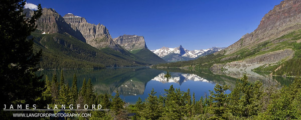 """""""Reflection Perfection""""  Glacier National Park, MT  Wild Goose Island is one of the most iconic scenes in Glacier National Park.  I've been past this location many times, but I have never seen the water this still.  I was able to quickly capture this image before a tour boat went by and destoryed the magic. Want to buy a print of this image?  Click Here!"""