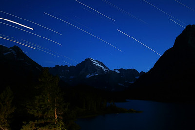 """""""Star Streaks""""  Glacier National Park, MT  If you ever make it to Glacier National Park, make sure you spend a night at the Many Glacier Hotel.  On this visit, we were fortunate to have a room overlooking the mountains in the distance.  I was able to leave my camera on my balcony to capture this scene of the stars. Want to buy a print of this image?  Click Here!"""
