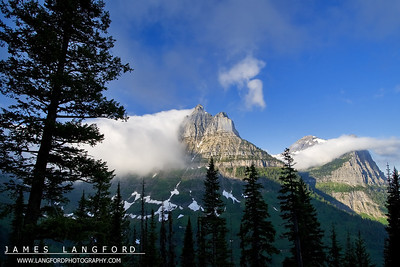 """""""Rolling Fog""""  Glacier National Park, MT  I really love visiting Glacier.  It's different everytime I go.  On this trip, the East side of the park was almost completely covered in fog.  As I drove over Logan's Pass from St Mary Lake, I found the West side of the Park clear.  The amazing fog was rolling off the tall mountains like water. Want to buy a print of this image?  Click Here!"""