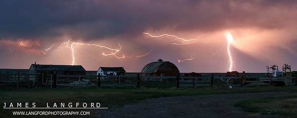 """Storms on the Prairie""  Central MT  I really enjoy chasing thunder storms.  This particular storm had been shooting off very large bolts of lightning, but they were not very frequent.  I was finally able to capture a huge discharge with this farm in the forground. Want to buy a print of this image?  Click Here!"