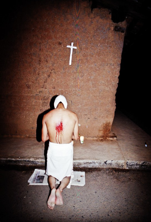 "Blood spills out from the back of this ""flagellente"" while he prays in one of many designated prayer stations."