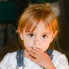 Beautiful toddler with big eyes looks at the camera