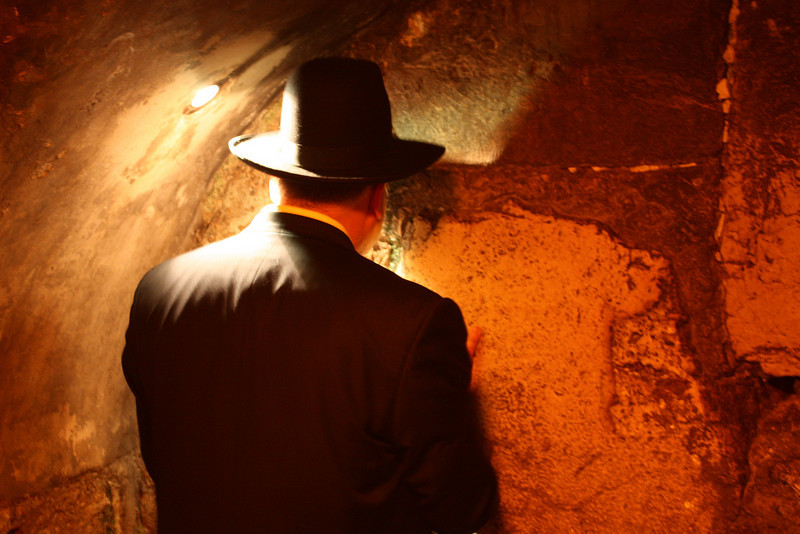 Jerusalem, tunnel under the Western Wall. Man praying at the closest location to the Holy of Holies. (July 2009) © Copyrights Michel Botman Photography