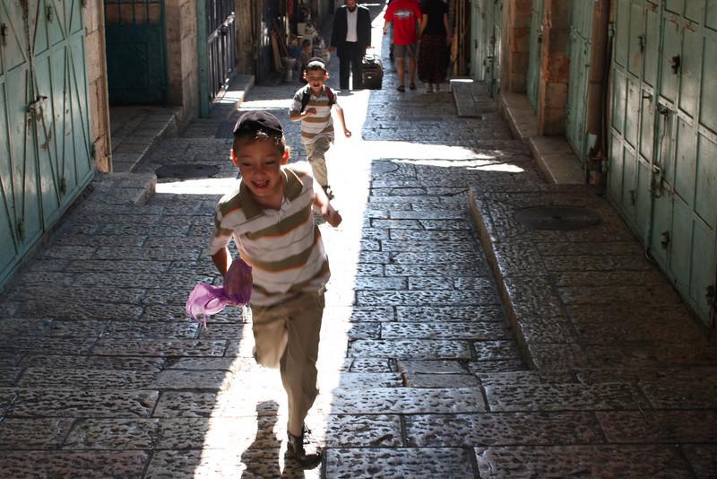 Jerusalem, twin Jewish boys running towards the Arab Market. (July 2009) © Copyrights Michel Botman Photography