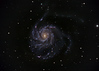 The Pinwheel Galaxy - M101 - July 1, 2011, Bryce Canyon, UT, Honis-modified Canon 450D w/ Baader UV/IR Cut Filter; Celestron C11 at f/6.3. Subs: 13x180secs; 4x300secs (59 min.) Processed with Nebulosity & CS5; master darks at 55deg F.<br /> M101 is a huge galaxy, almost twice as large as our Milky Way, that is being shredded by tidal forces generated by nearby companion galaxies.<br /> 1st Place Award - 2011 ALCON Imaging Contest, Bryce Canyon, UT