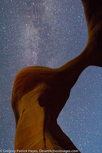 Metate Arch in The Devil's Garden with the Milky Way. There is a Lone Meteor from the Perseid Shower right below the delicate portion of the Arch.