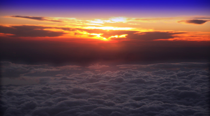 Sunset above the clouds, flying back into Boise.