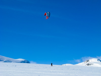 Kiting is not only done on a board on the water, but also on snow, using skis. This is from Hovden in Setesdal, Norway - a popular ski resort.