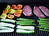 B.B.Q. italian style: steaks, red and yellow peppers, zucchinis and asparagus