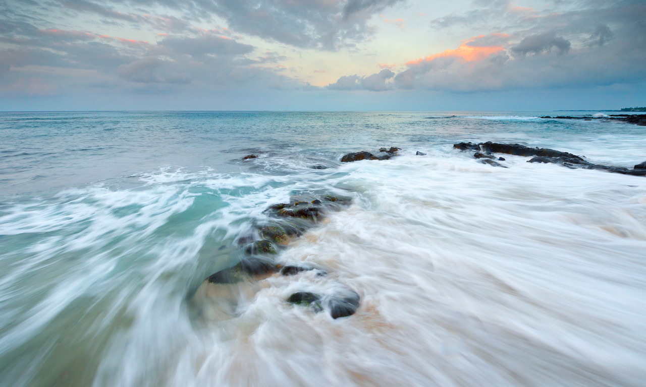 Water and Light, Kona Coast - Hawaii<br /> <br /> On the western edge of the big island of Hawaii,  the small town of Kailua Kona sits almost on top of this tiny cove - Oneo Bay. Soft white sands and jets of coal-black lava rock line this peaceful village attraction.