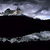 Patagonia - Chile<br /> <br /> Violent winds tear at the black tips of the Cuernos del Paine massif. Patagonian Andes, Chile