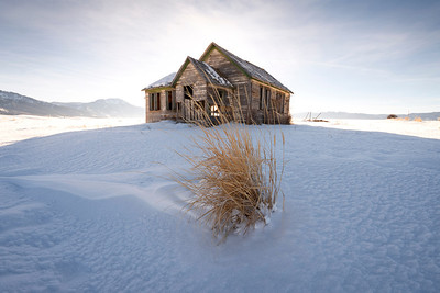 Little House on the Prairie, Swan Valley - Idaho  A  desolate empty home stands alone along the wintery plains of Swan Valley, along the fertile eastern edge of Idaho. I know nothing of this house, and its many families, but my imagination fills its walls with many tales.