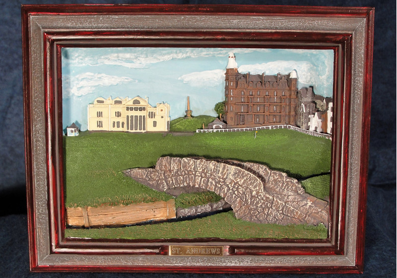 St. Andrews Golf Course - Framed Relief Sculpture.  This is a deep relief sculpture of a historic view of St. Andrews golf course, club house and the iconic Swilcan Bridge.