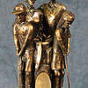 Golf Family Award - Cold cast bronze statuette.  Commissioned to create an award for a family golf outing.  An engraved plate would be set in the space in front.