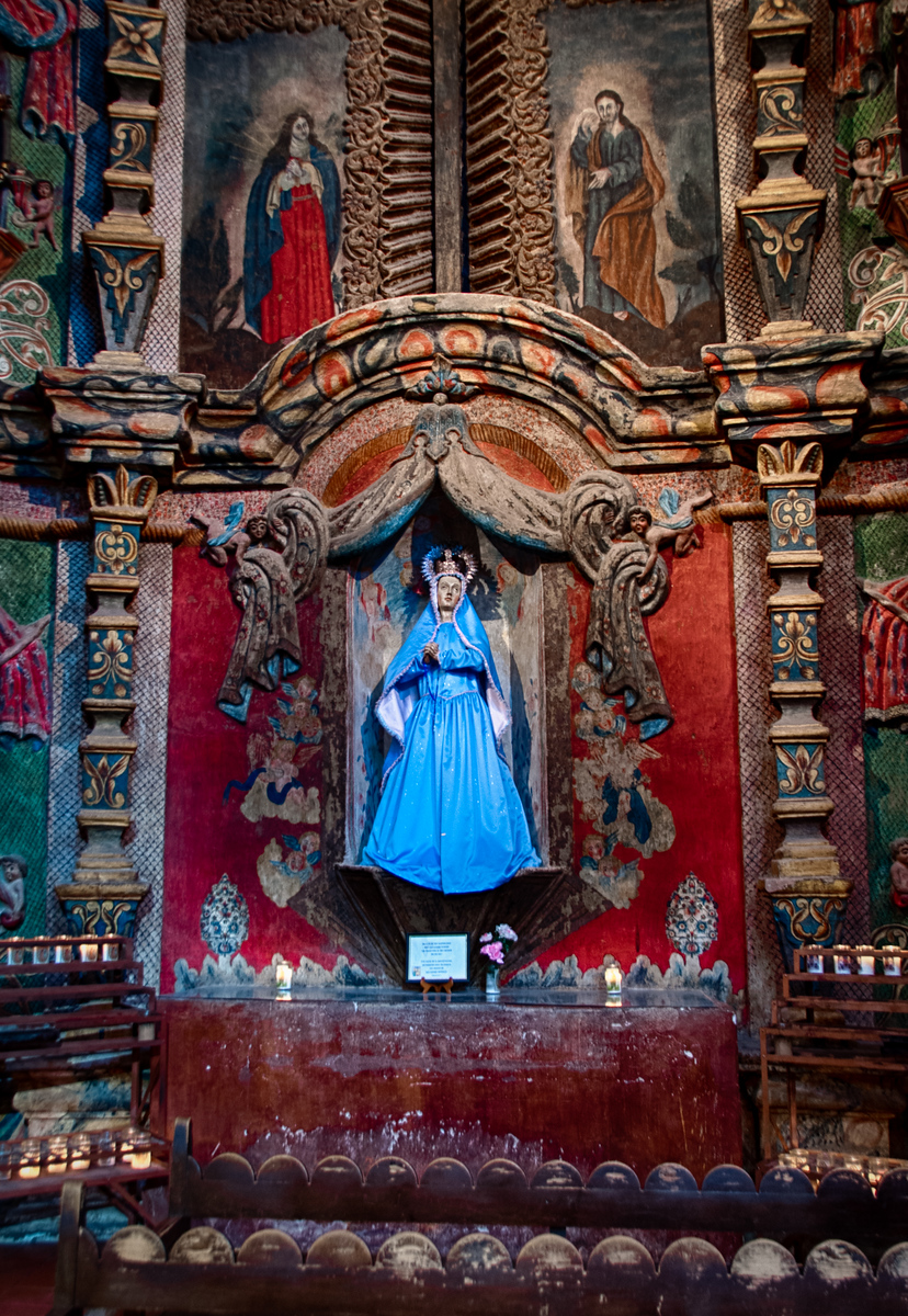 Statue of Mary, Mother of Sorrows, Mission San Xavier del Bac, Tucson, Arizona. Painting above are images of Mary and John at the crucifixion.