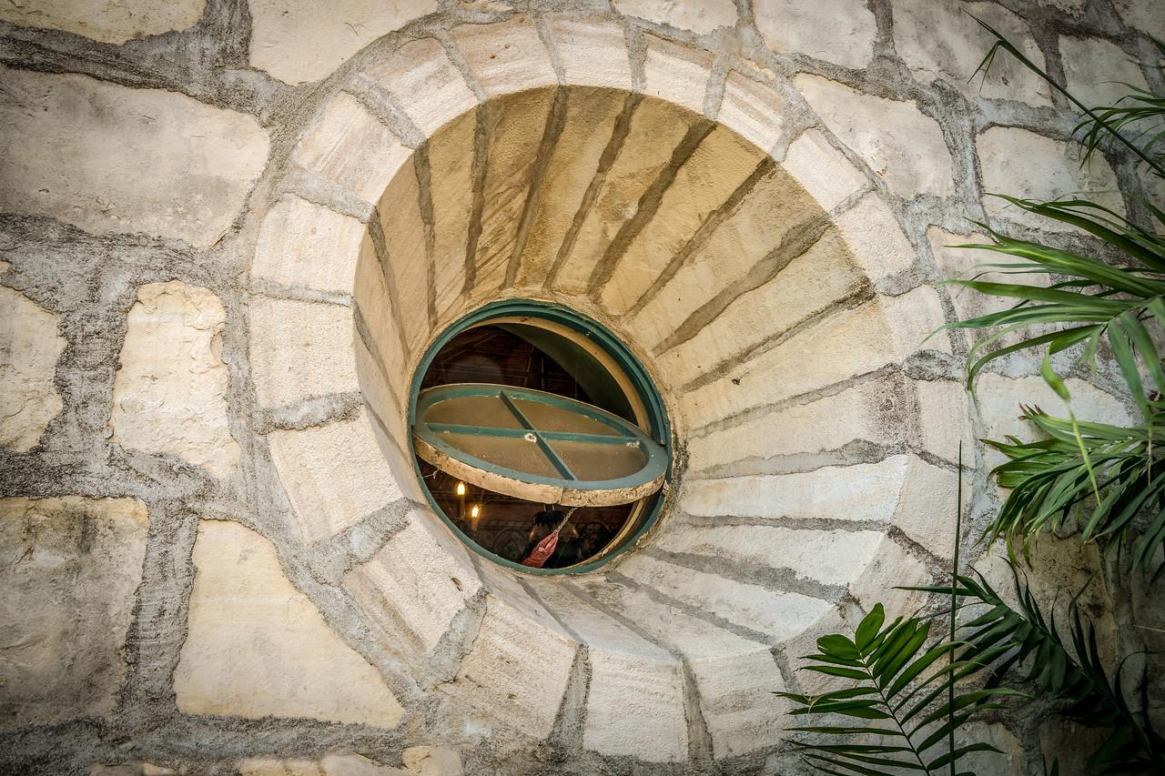 Window at base of bell tower, Mission Santa Barbara