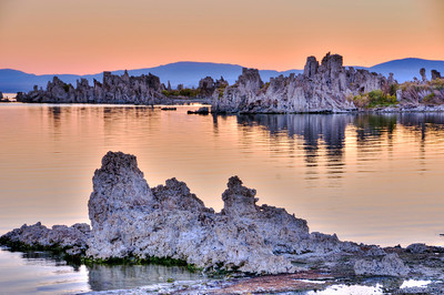 Mono Lake Sunrise.   First light over Mono Lake, Ca.  The sun hadn't risen yet, but the orange/pink light cast a glow upon the water.