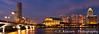 The downtown Singapore skyline illuminated at night.