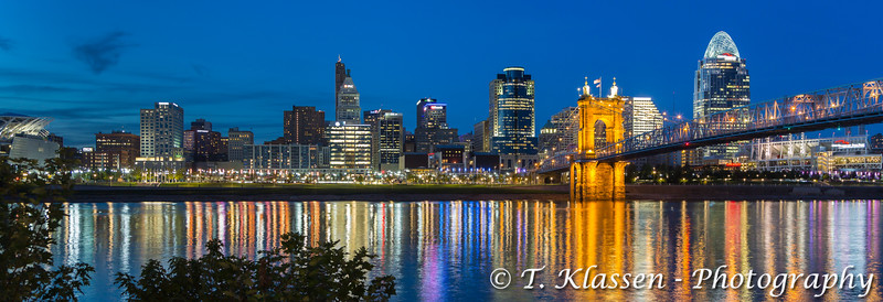 The city skyline and reflections in the Ohio river at dusk in Cincinnati, Ohio, USA.