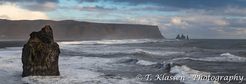The rocks and surf of the Dyrhólaey Coast in southern, Iceland.