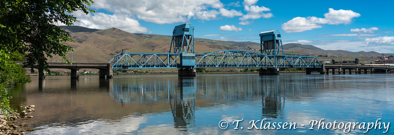 The Lewiston-Clarkston Bridge  reflected in the Snake River from Clarkston, Washington, USA.