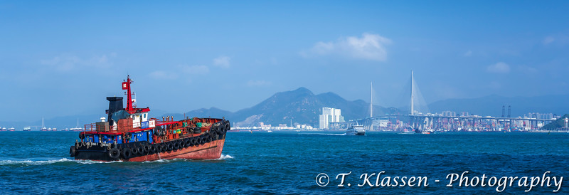 Turbo Jet Macau ferry boat traffic in Victoria Harbor, Hong Kong, China, Asia.
