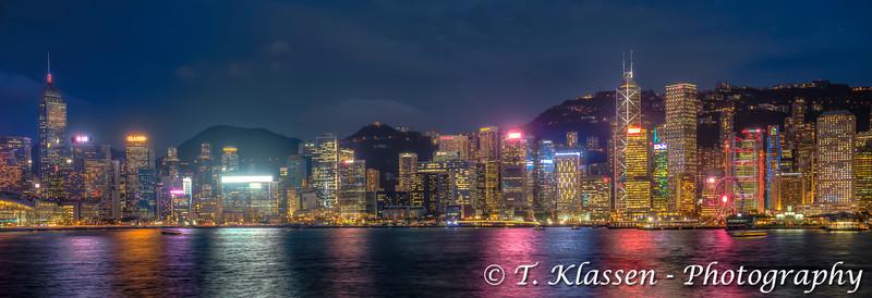 The Hong Kong Island skyline illuminated at night from Tsim Sha Tsui, Kowloon, Hong Kong, China, Asia.