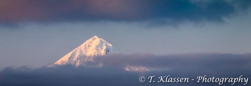 The snowy peak of Mount Shishaldin volcano on Unimak Island in the Aleutian Islands near Unimak Passage, Alaska, USA.