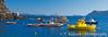 Colorful fishing boats in Ammoudi Bay near Oia, Thira, on the Greek Island of Santorini, Greece.