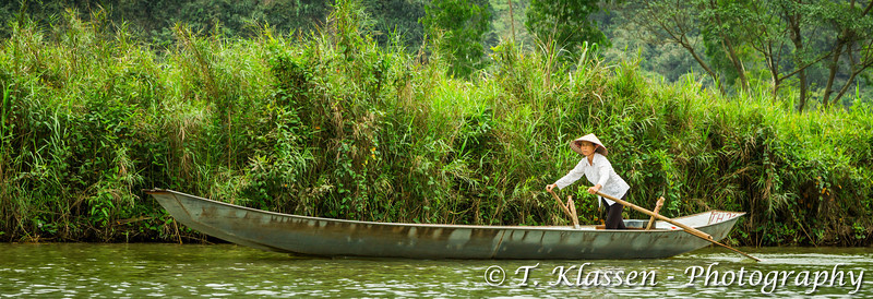 A lady rowing a boat on the Yen River to the Perfume Pagoda near Hanoi, Vietnam, Asia.