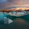 <H3>Icy Alpenglow </H3> Dawn at Jokulsarlon, South Iceland
