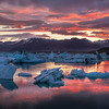 <H3>Fiery Sunrise over Iceberg Lagoon</H3> How is this for a 2:30am sunrise? This was the best nights sleep I didnt have....ever! Its hard to pick one favourite place in Iceland as there are just too many gorgeous locations all around, but if I had to pick one moment in particular, it would be this. I had Jokulsarlon all to myself as I saw the morning light paint the floating icebergs.