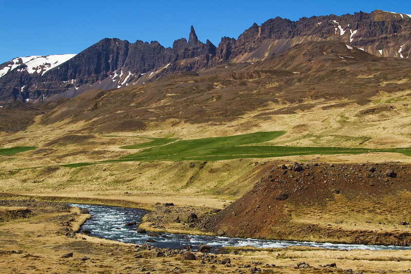 <H3> Sinister Peaks </H3> Near the northern city of Akureyri, these jagged spires looks down onto the narrow valley of Oxnadalur