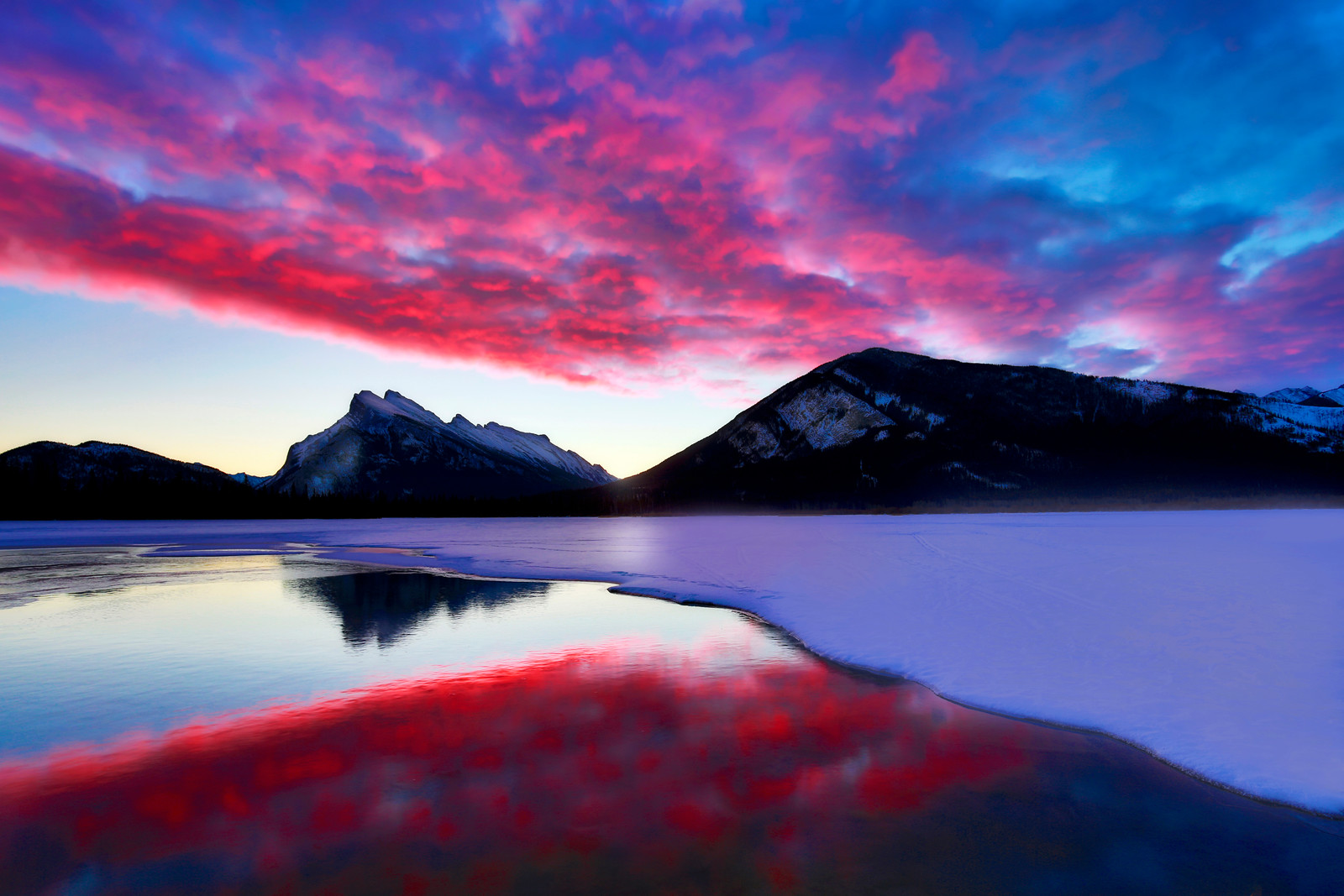 ~Fire & Ice~<br /> <br /> My wife & I spent a few days exploring wilderness areas & lakes in Banff National Park. This is Lake Vermillion with Mount Rundle in the background. The hot springs seep into the lake that allow a few pools to remain open even though the rest of the lake is frozen. Each morning we would get up before daylight hoping the light would be good. This was taken on the second morning. When we arrived the sky was cloudless and I was pretty disappointed until I looked behind me and noticed the clouds were moving slowly towards the mountain overhead.