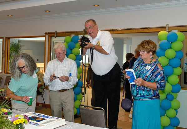 Steve just before he fell into the cake! - CPS Photo Exhibit at Cleveland Hopkins Airport