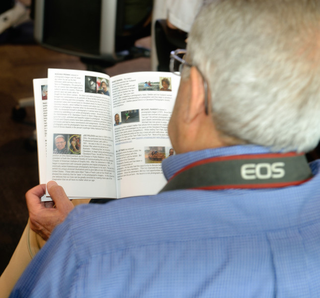 Joe reading up on himself!!! - CPS Photo Exhibit at Cleveland Hopkins Airport