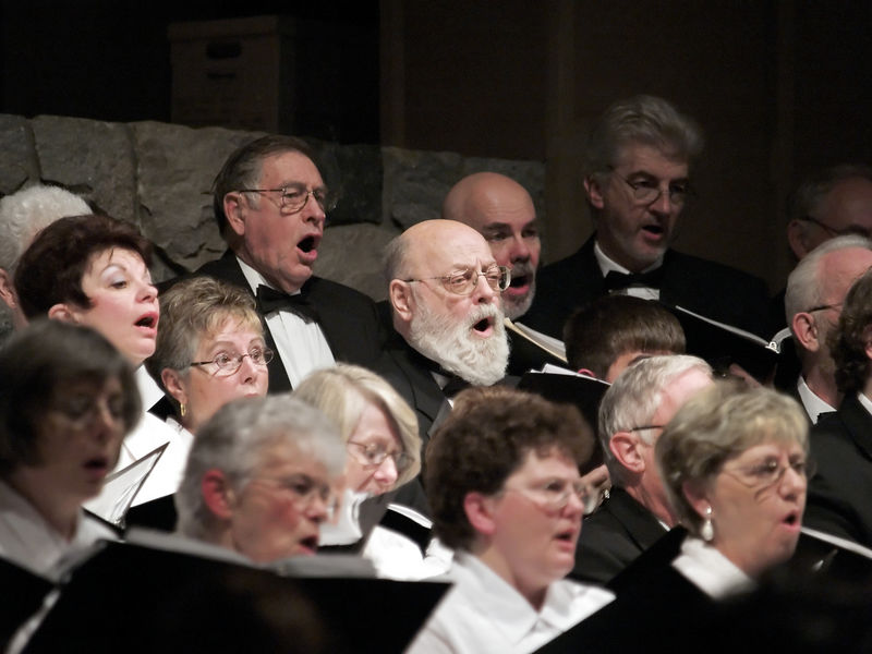 Closeup of some of the tenors and altos of the Symphony Singers.