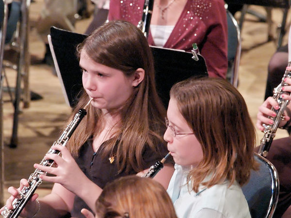The oboists follow the conductor.  The one on the left is my youngest, Emily.