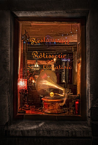 Grammophone Dreams Paris. The restaurant was closed, but the grammophone held the promise of a wonderful meal tomorrow. Shot from the outside, there were reflections and schmears galore on the window glass. But I think that's cool. 'Cause I love how it's grungy on the outside, soft and warm and musical on the inside. Like a really good friend.    ©Karen Hutton - Creative Commons (CC BY-NC 3.0)
