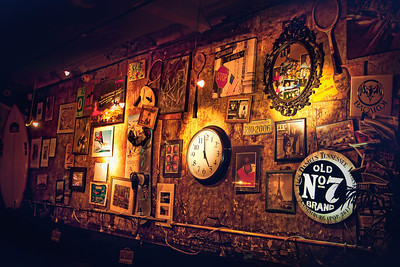 "Home Is With YouBar Wall, Paris  She gazed at the wall, full of oddball treasures and tidbits that mostly resembled her memories.  ""You know"" she said quietly, not looking at him directly, but instead holding him just inside her peripheral view,  ""No matter where or when we go... home will always be with you.""  He smiled.  She sighed.  The clock ticked 5pm.    ©Karen Hutton - Creative Commons (CC BY-NC 3.0)"