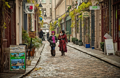 Ladies Who Stroll I use the word 'stroll' lightly. Because these particular ladies in the Marais neighborhood of Paris were covering some major groundage. I wondered what they were talking about, so immersed were they. Work? Clothes? Boyfriend? Girlfriend? Working out? Problems of the world? I wondered if they were native Pariesiennes, or if they moved here from another land. And if they were happy there.  I admired their fashion sense, as I did most of the women I saw in Paris.   Then they swooped by and were gone.    ©Karen Hutton - Creative Commons (CC BY-NC 3.0)