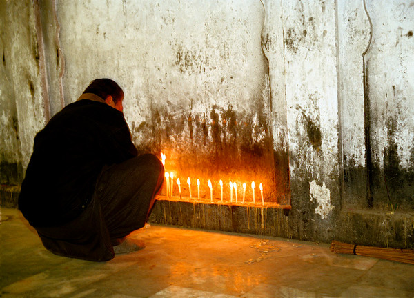 Anonymous, Pilgrim, 2007 Signed, Limited Edition, Archival Giclee Print, 5/10 $250 Unframed/$350 Framed  Having grown up in Montreal, I have often taken guests St. Joseph's Oratory and observed people light candles in prayer. This photograph was taken at a Muslim Saint's shrine in Lahore, Pakistan where I was struck by the similarity of the candle lighting ritual across religions.