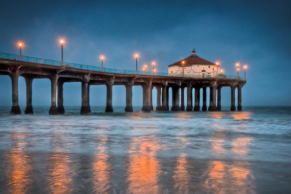 Just after sunrise, I got this photo at Manhattan Beach. I cleaned up the noise and some other things in Photoshop.