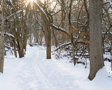 Walking the path at Mounds State Park this winter during sunset