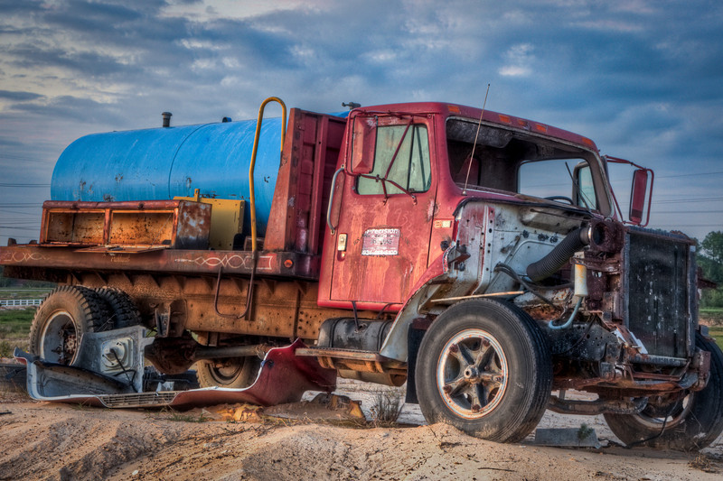 An abandoned truck at the far side of a plateau in Katy, TX. It was almost too dark at this point, but I was able to get this shot with my tripod. HDR photo.