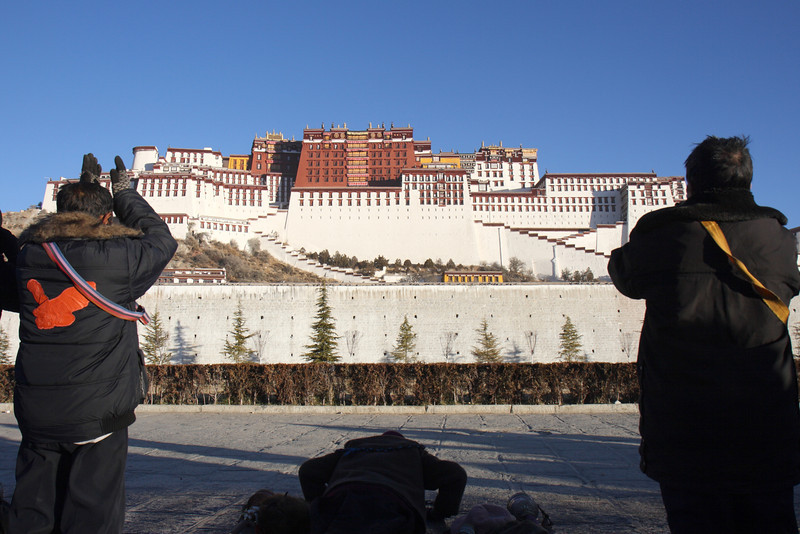 Prostration in front of the Potala Palace, Lhasa, Tibet.